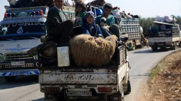 File Photo: Internally displaced people from various areas under YPG control, arrive to the recently captured by the Free Syrian Army village of Qestel Cindo, Afrin. EPA,AREF TAMMAWI