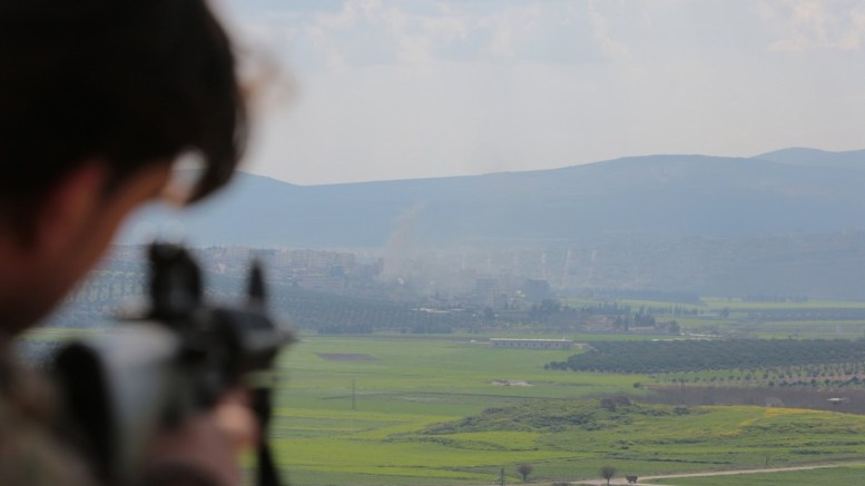 Turkey-backed Free Syrian Army soldiers aims his machine gun during an offensive, at Der Mismis Village, southeast of Afrin, Syria, 14 March 2018. According to media reports, the Turkish army and its allied Syrian militias continued to encircle the city of Afrin in the Kurdish-held enclave of the same name in northwest Syrian, taking control of nine towns. EPA, STR