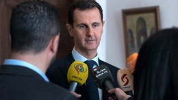 A handout photo made available by Syria's Arab News Agency (SANA) shows Syrian President Bashar Assad speaking with reporters in Damascus, Syria, 04 March 2018.  EPA, SANA HANDOUT HANDOUT EDITORIAL USE ONLY