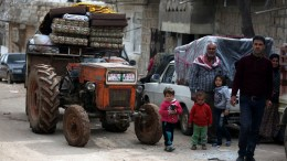 Civilians carry their belongings at the recently captured city of Afrin, Syria, 19 March 2018.  EPA,AREF TAMMAWI