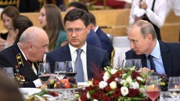 File Photo: Russian President Vladimir Putin speaks with a guest as Russian Energy Minister Alexander Novak looks on during an event in Moscow, Russia. EPA, ALEXEI NIKOLSKY
