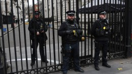 File Photo: British armed police on guard outside the gates of 10 Downing Street in central London, Britain. EPA, ANDY RAIN