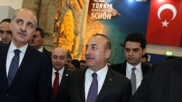 File Photo: Turkish Foreign Minister Mevlut Cavusoglu (C) and Turkish Minister of Culture and Tourism, Numan Kurtulmus (L) visit the Turkish hall in the International Travel Trade Show, in Berlin, Germany. EPA, FELIPE TRUEBA