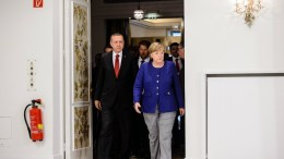 German Chancellor Angela Merkel (R) and Turkish President Recep Tayyip Erdogan (L) in the Hotel Atlantic, in Hamburg, Germany. EPA, JENS SCHLUETER, POOL