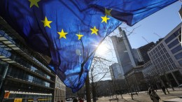 File Photo: An EU flag fly in Frankfurt Main. EPA, ARMANDO BABANI