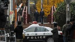 FILE PHOTO. Policemen walk inside the police control line at Tokyo, Japan. EPA,KIMIMASA MAYAMA