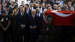 File Photo: Turkish President Recep Tayyip Erdogan (3-L) and Chief of Staff General Hulusi Akar (2-L) watch the coffin of Turkish Major General Aydogan Aydin who was killed in a helicopter crash in Sirnak, being carried away during his funeral ceremony in Ankara, Turkey. EPA, TUMAY BERKIN