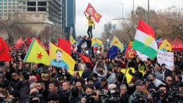 Syrian Kurdish refugees carry the Kurdish YPG forces flag and the pictures of Abdullah Ocalan the head of Kurdistan workers party during a demonstration against the Turkish military operation in Syria's Afrin, in Sulaymaniya, Kurdistan Region of Iraq. EPA, AFAN ABDULKHALEQ