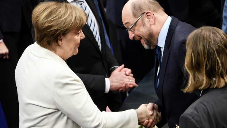 Member of the Bundestag and former SPD chancellor candidate and party leader Martin Schulz (R) congratulates German Chancellor Angela Merkel (L) after her re-election as the Federal Chancellor at the Bundestag in Berlin, Germany, 14 March 2018. EPA, CLEMENS BILAN