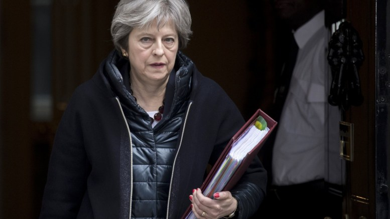 Britain's Prime Minister Theresa May leaves No. 10 Downing Street to attend the Prime Minister's Questions in the Houses of Commons, in London, Britain, 14 March 2018. Mrs May is expected to update the Commons on Britain's reaction to the alleged involvement of Russia in the poisoning of ex-Russian spy Sergei Skripal and his daughter who were attacked with a nerve agent on 04 March 2018 in Salisbury. EPA, WILL OLIVER
