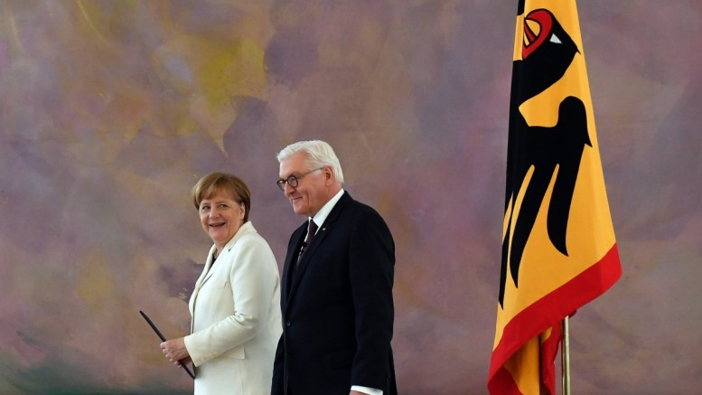 German Chancellor Angela Merkel (L) and German President Frank-Walter Steinmeier (R) after the appointment of the Federal Chancellor at the Bellevue Castle in Berlin, Germany, 14 March 2018. A coalition of Christian Democratic Union (CDU), Christian Social Union (CSU) and Social Democratic Party (SPD) forms the new German government. EPA, FILIP SINGER