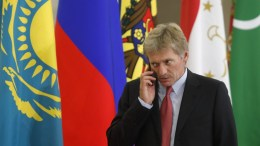 File Photo: Kremlin spokesman Dmitry Peskov speaks on the phone before a session of the Council of Heads of the Commonwealth of Independent States (CIS) in the Black sea resort of Sochi, Russia. EPA, MAXIM SHEMETOV,  POOL