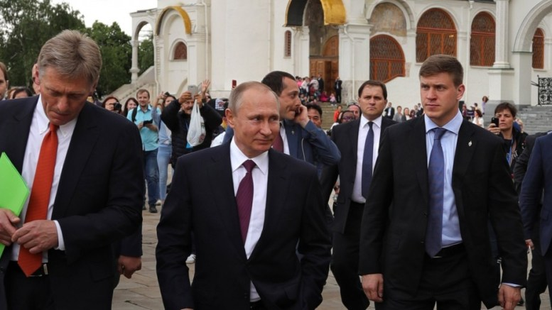 File Photo: Russian President Vladimir Putin (2-L) and Kremlin spokesman Dmitry Peskov (L) have a walk around the Kremlin in Moscow, Russia. EPA, MICHAEL KLIMENTYEV, SPUTNIK, KREMLIN POOL MANDATORY CREDIT