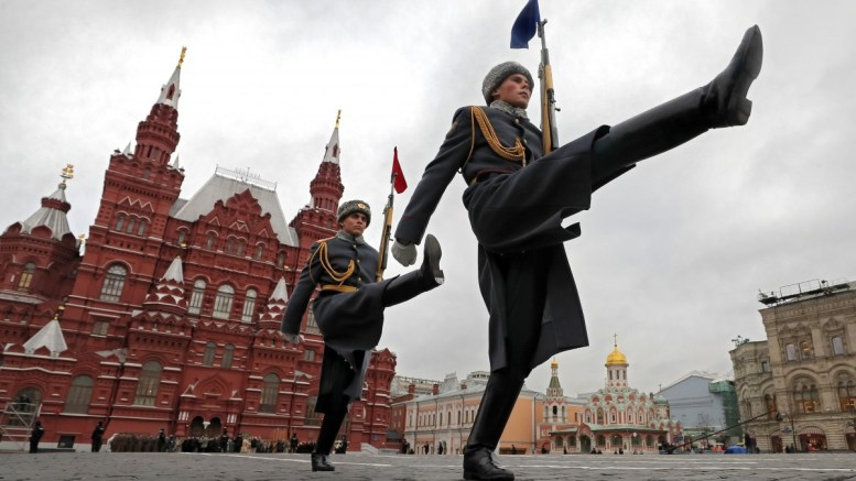 Russian soldiers in historical uniforms take part in a military parade on the Red Square in Moscow EPA, YURI KOCHETKOV