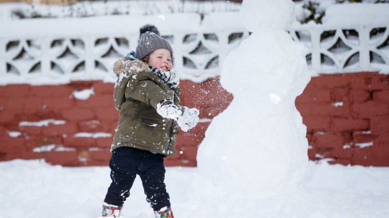 File Photo: A young boy enjoys playing in the snow. EPA,ROBERT PERRY