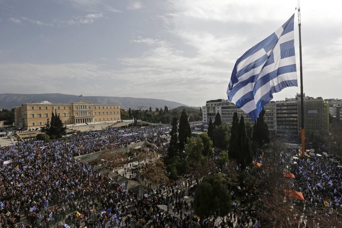 A huge Greek flag waves  in Athends, Greece. EPA, YANNIS KOLESIDIS
