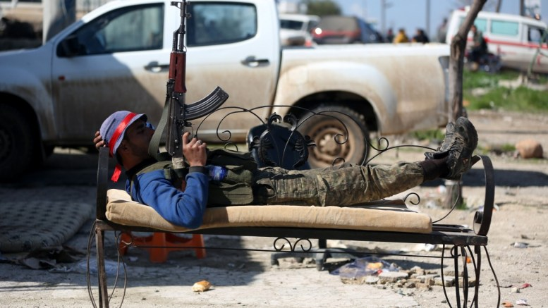 A Free Syrian Army soldier rests prior to an offensive, at the newly captured Kafr Jana village, Afrin, Syria, 09 March 2018. The Turkish-backed Free Syrian Army is an armed rebel military group that operates in northern Syria and is supported by the Turkish army. EPA, AREF TAMMAWI