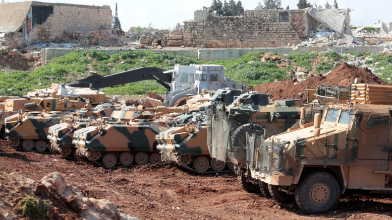 File Photo: Turkish tanks and vehicles waits in village of Qestel Cindo, Afrin region Syria. EPA, STR
