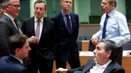 FILE PHOTO.  President of the European Central Bank (ECB) Mario Draghi (2-L standing) tries to speak with Greek Finance Minister Euclid Tsakalotos (R-seated) at the start of a Eurogroup Finance Ministers' meeting at the EU Council, in Brussels, Belgium. EPA, OLIVIER HOSLET