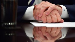 US President Donald J. Trump's hands are seen as he holds a law enforcement roundtable on sanctuary cities, in the Roosevelt Room at the White House in Washington, DC, USA, 20 March 2018. EPA, KEVIN DIETSCH
