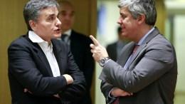 File Photo: Ο υπυοργός Οικονομικών Ευκλείδης Τσακαλώτος με τον πρόεδρο του Eurogroup EPA, OLIVIER HOSLET