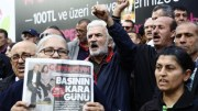 File Photo: People chant anti-government slogans and hold Cumhuriyet newspaper as they gathered in front Turkish newspaper Cumhuriyet publishing house EPA, CEM TURKEL