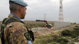 File Photo: A UNIFIL soldier watches from Lebanon's side the construction work of a dividing wall along the Israeli - Lebanon border, in Naqoura, Lebanon. EPA, WAEL HAMZEH
