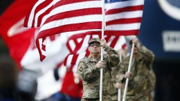 FILE PHOTO.  A US Army soldier carries the American flag on to the field. EPA, CJ GUNTHER