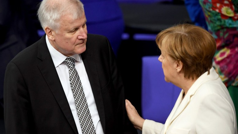 File Photo: German Chancellor Angela Merkel (R) talks with Minister of Interior, Construction and Homeland, Horst Seehofer (L). EPA, CLEMENS BILAN