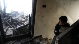 A child looks at damages inside a house damaged after overnight shelling on Douma, eastern Ghouta, Syria, 19 March 2018. According to reports, at least nine people were killed after forces loyal to the Syrian government reportedly carried out strikes on Douma. Government forces launched a massive offensive against eastern Ghouta on 18 February, which has killed around 1,400 civilians, including 271 minors and 174 women, the Syrian Observatory for Human Rights said. A total of 50,000 evacuees had left Eastern Ghouta in the last 72 hours. EPA,MOHAMMED BADRA