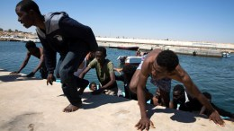 File Photo: Migrants disembark a boat after they were rescued by Libyan coastguard in the Mediterranean off the Libyan coast, in Tripoli, Libya. EPA, STRINGER