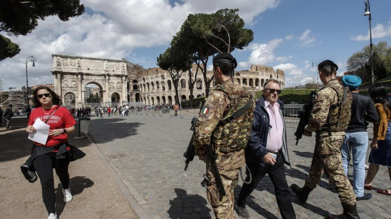 FILE PHOTO: Italian soldiers patrol next to the Arch of Costantine in central Rome, Italy, 29 March 2018. Italian Interior Minister Marco Minniti called for an ulterior reinforcement of security checks at crowded places during the Easter holidays. EPA.GIUSEPPE LAMI