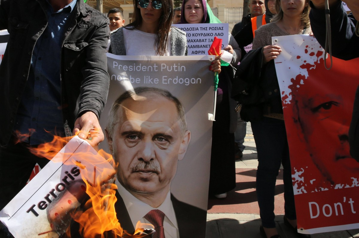File Photo: Kurdish demonstrators who live in Cyprus burn an image of the Turkey's President Recep Tayyip Erdogan during a protest against the Turkish offensive targeting Kurds in Afrin, Syria, outside of the Russian embassy in Nicosia, Cyprus. EPA, KATIA CHRISTODOULOU
