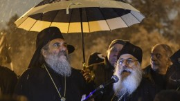 """File Photo: Two members of holy synod of so-called """"Macedonian"""" orthodox church, bishops Agatangel (L) and Petar (R) address the crowd during a protest against the change of the constitutional name of FYROM in Skopje. EPA, GEORGI LICOVSKI"""
