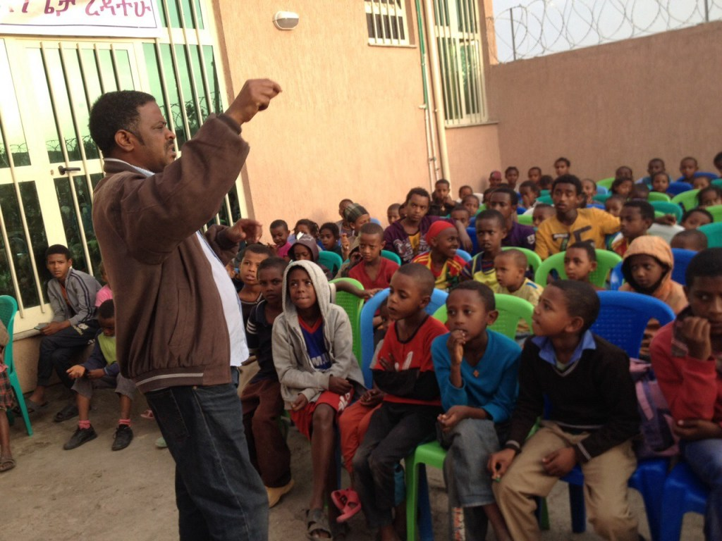Pastor Tatek teaching children 2015