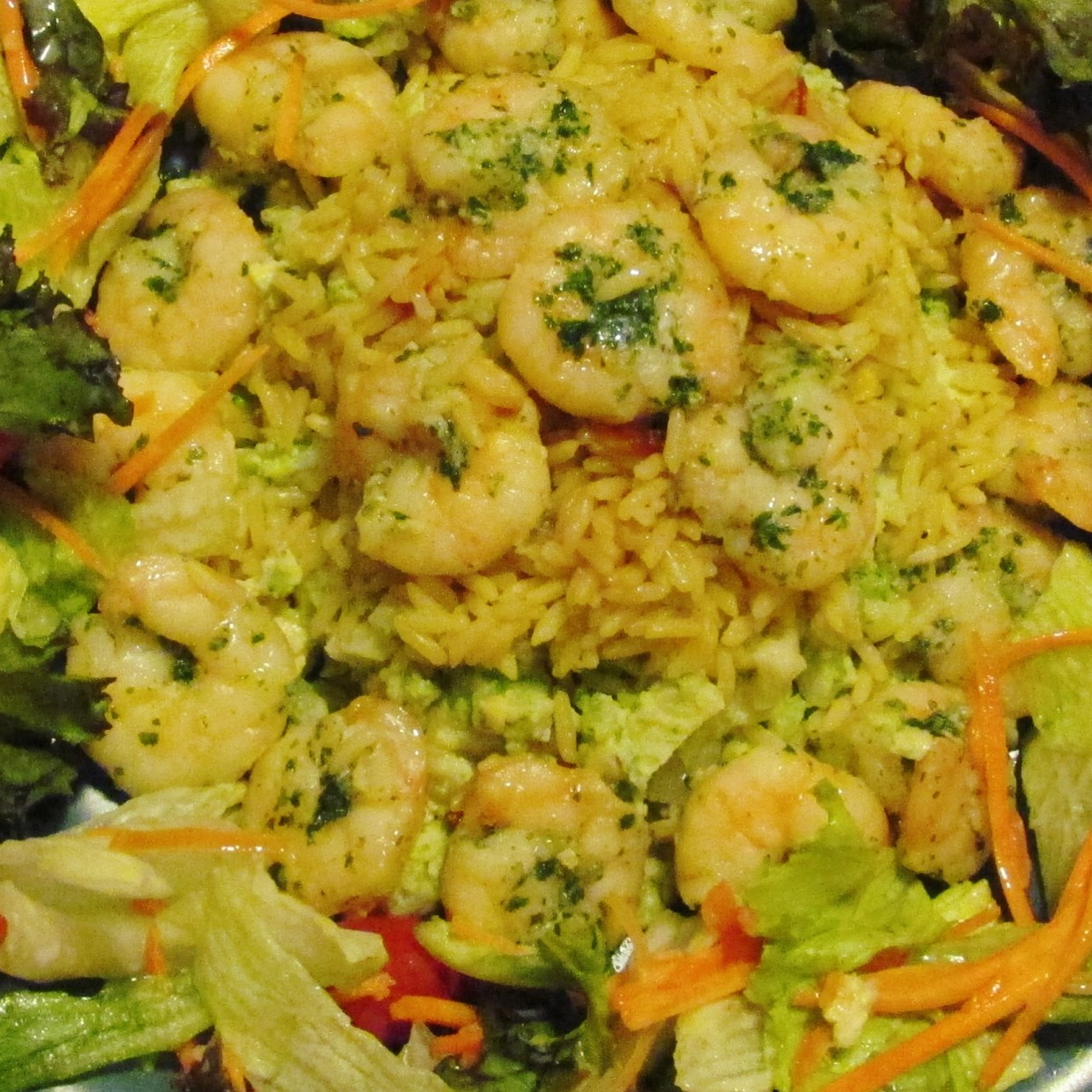 healthy broccoli under a bed of prawns & side salad