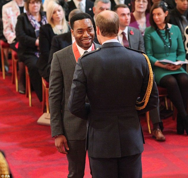 British Nigerian actor Chiwetel Ejiofor receiving his Commander of the British Empire from Prince William