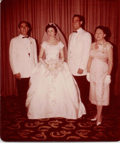 Harold Reuben Ribakow and bride, possibly his father Delmas Mayer Rubikow on left, his mother Loretta (Cooper) Ribakow on right. Summer, 1959.