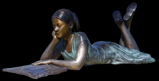 girl book statue