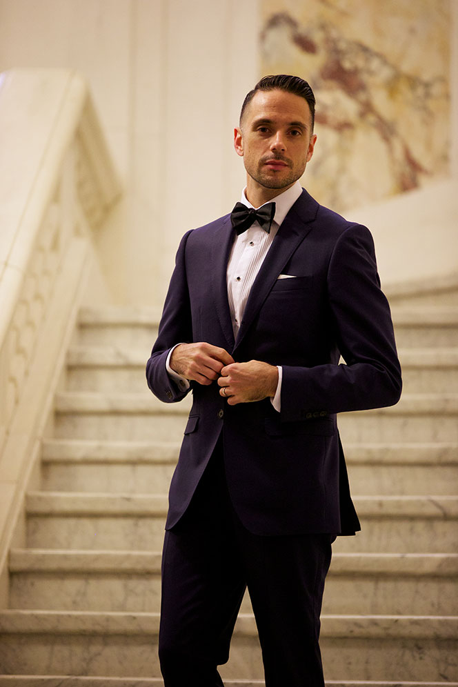 blue suit black tie he spoke style