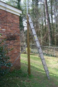 With the 4X4 post in concrete, a ladder can be leaned against it to enable one to push the mast up with the hex beam on it.
