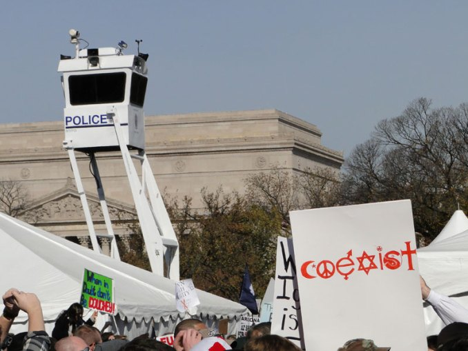 Police forces watch over the crowd at the Rally to Restore Sanity and/or Fear on October 30, 2010. (Photo By: heydayjoe)
