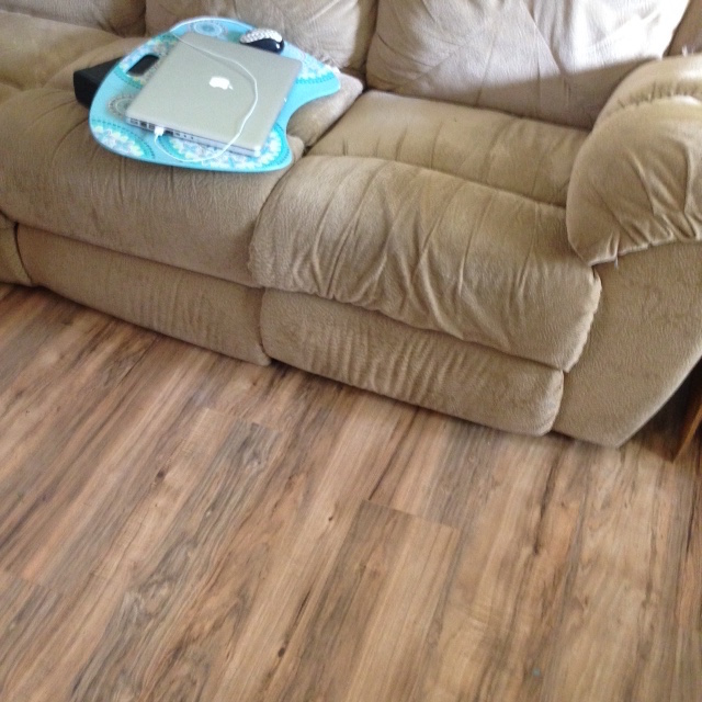 clean floor and clutter free couch