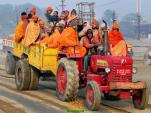 Sadhus Arrive by a Tractor