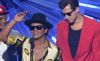 "FILE - In this Aug. 30, 2015, file photo, Bruno Mars, left, and Mark Ronson accept the award for male video of the year for ""Uptown Funk"" at the MTV Video Music Awards in Los Angeles. Apple announced Wednesday, Dec. 9, 2015, that Ronson and Mars' ""Uptown Funk"" was the year's biggest single on iTunes for 2015. (Photo by Matt Sayles/Invision/AP, File)"