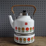 white enamel kettle with flower border