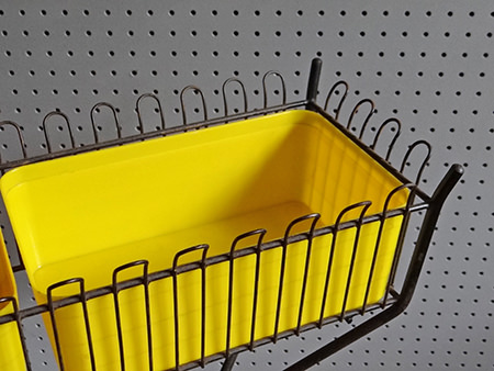 detailed view of yellow plastic &amp black metal Atomic plant stand