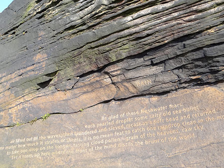 Simon Armitage's 'Rain' poem carved into rock at Cow's Mouth Quarry, near Blackstone Edge on the West Yorkshire/Greater Manchester border
