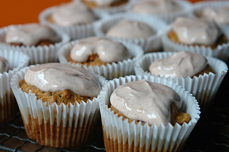 Adding Quark topping to the carrot muffins