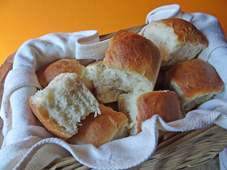 Freshly baked express rolls in a tea towel lined basket | H is for Home
